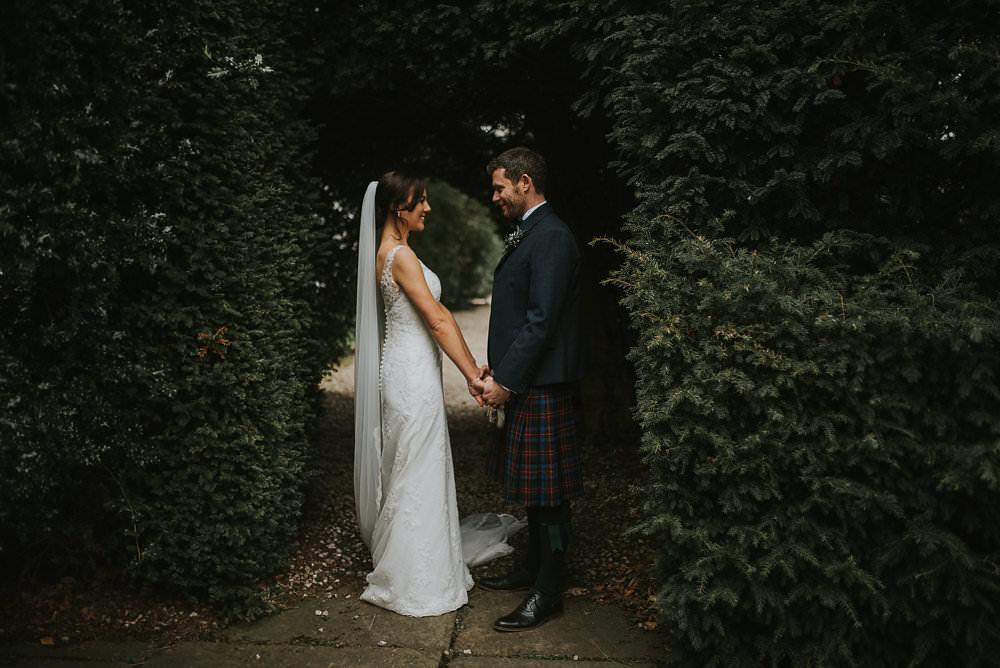 Bride Bridal Lace Sweetheart Neckline Straps Sleeveless Cathedral Veil Kilt Groom Bow Tie Bouquet Eucalyptus Macdonald Houston Hotel Wedding Martin Venherm Photography