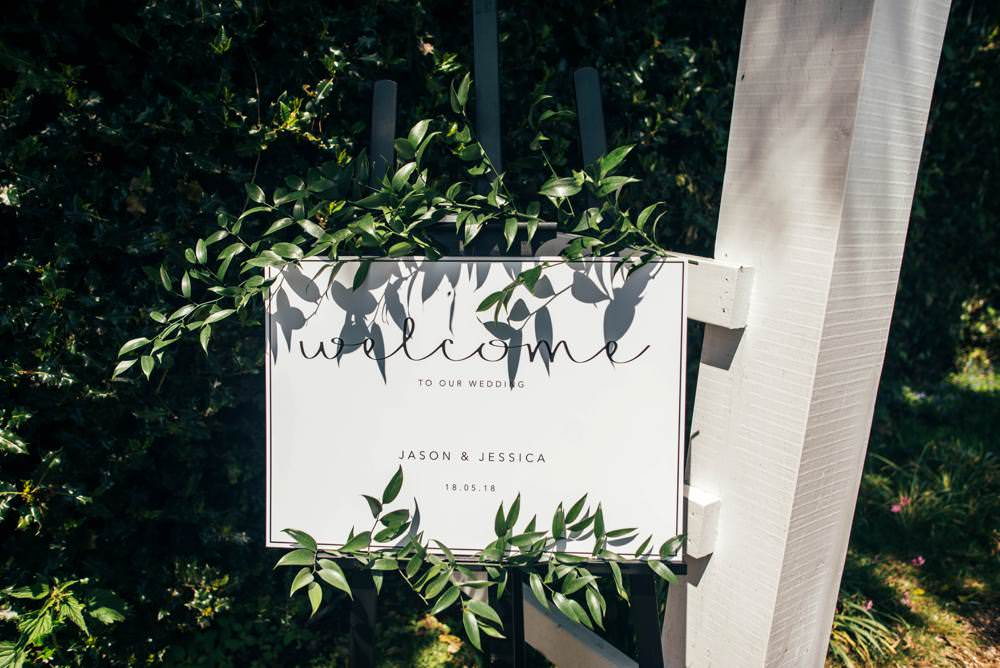Modern Calligraphy Sign Welcome Greenery Warm Welcoming Wedding Three Flowers Photography