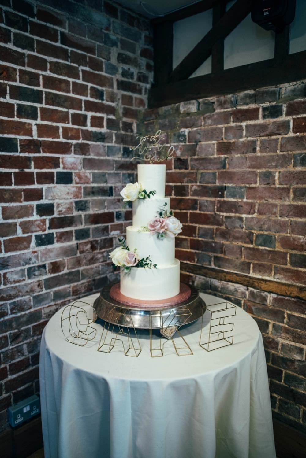 Tall Iced Cake Modern Flowers Warm Welcoming Wedding Three Flowers Photography