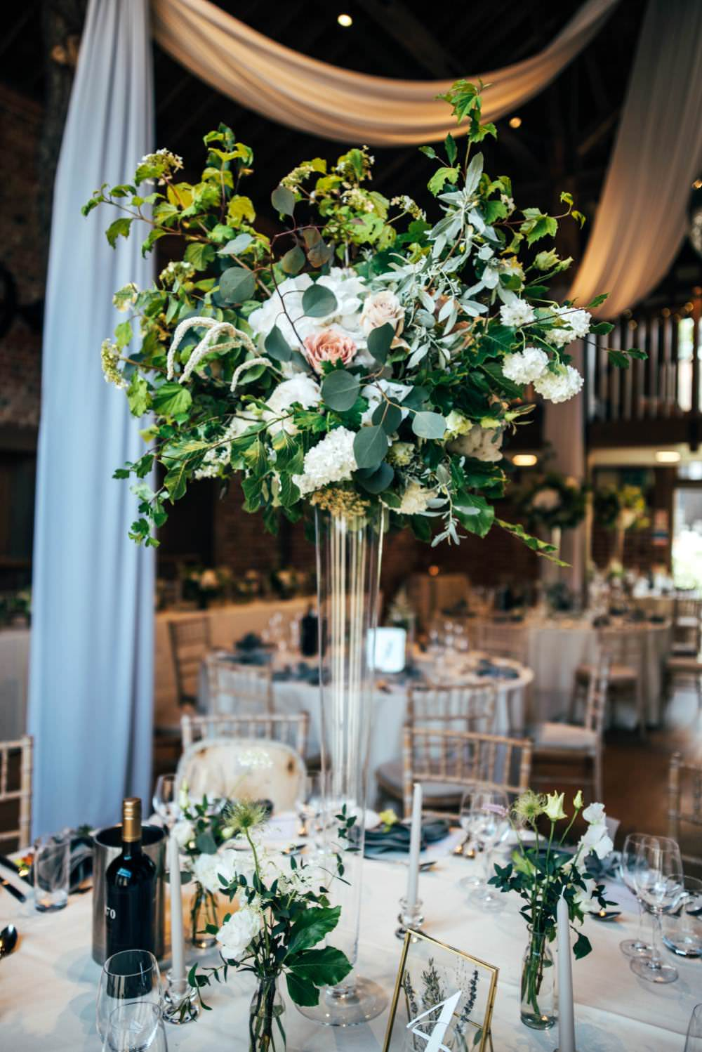 Tall Centrepiece Table Decor Flowers Greenery Foliage Warm Welcoming Wedding Three Flowers Photography