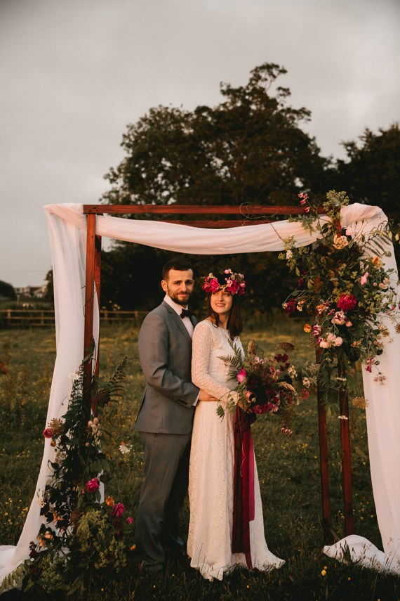 Flower Arch Backdrop Flowers Dark Red Burgundy Marsala Oxblood Pink Magenta Fabric Wooden Peony Peonies Rose Antique Moody Floral Farm Wedding Ideas Jemma King Photography