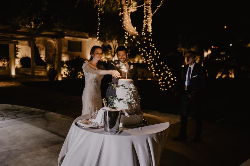 Bride Bridal Fishtail Lace Cap Sleeve Sweetheart Dress Gown Groom Dark Grey Waistcoat Cake Cutting Sparkler Greece Destination Wedding Elena Popa Photography