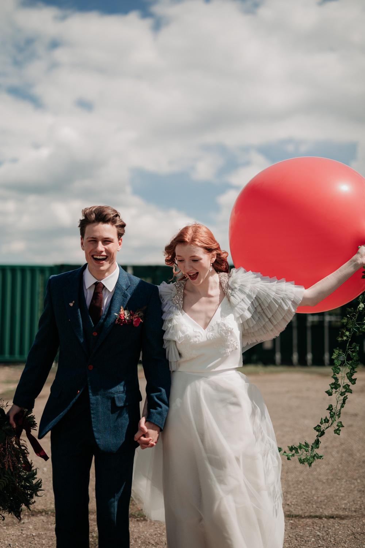 Giant Balloon Bride Groom Industrial Luxe Wedding Ideas Balloon Installation Ayelle Photography