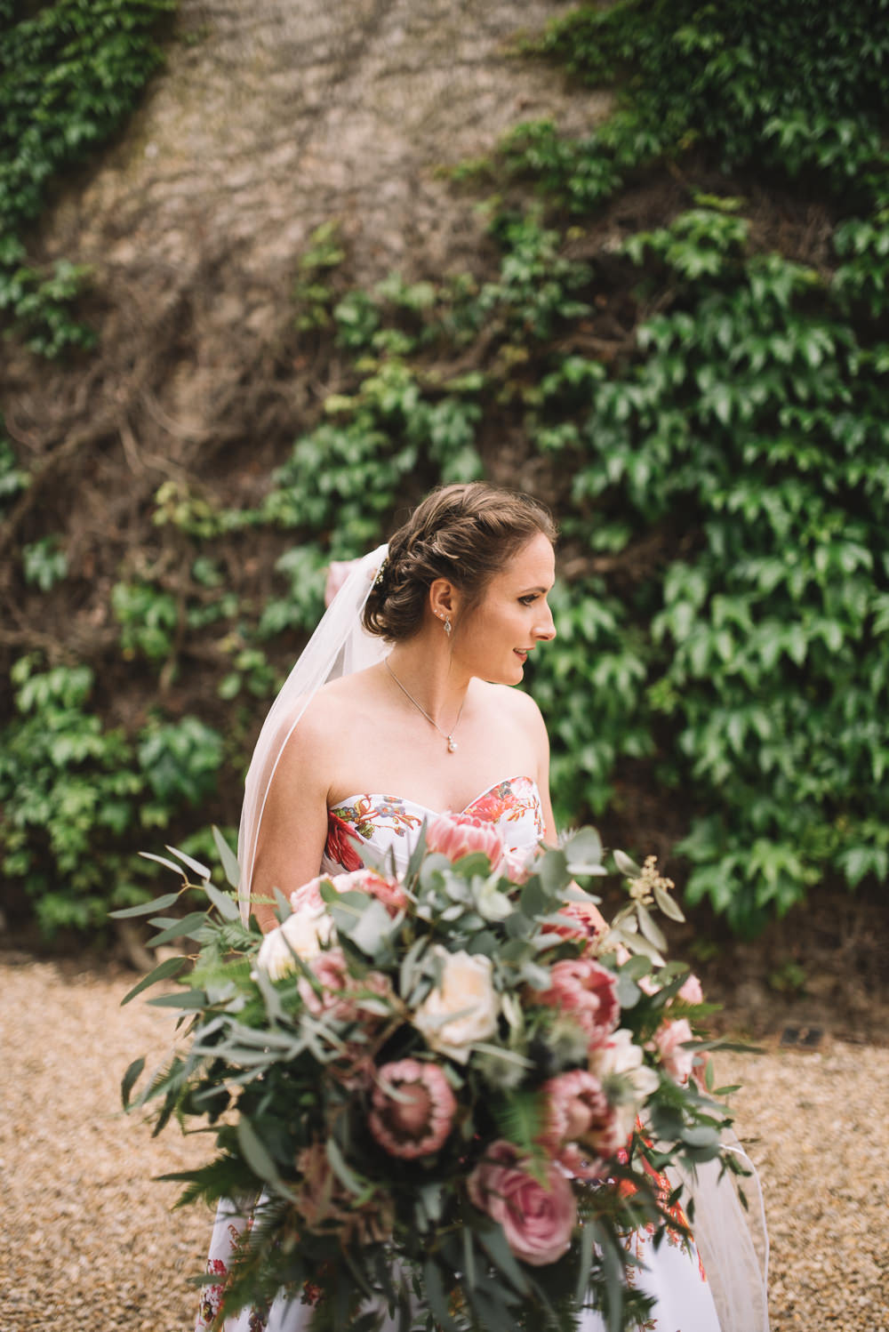 Bride Bridal Bouquet Flowers Greenery Foliage Large Protea Wild Whimsical Natural Irnham Hall Wedding Lucie Watson Photography
