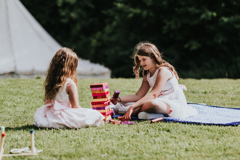 Keeper and The Dell Boho Farm Field Marquee DIY Alternative Rustic Outdoor Garden Games Jenga Kids | Relaxed Outdoor Wedding with 1000 Rainbow Origami Cranes Dan Biggins Photography