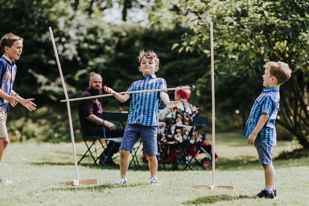 Keeper and The Dell Boho Farm Field Marquee DIY Alternative Rustic Outdoor Garden Games Limbo Kids | Relaxed Outdoor Wedding with 1000 Rainbow Origami Cranes Dan Biggins Photography