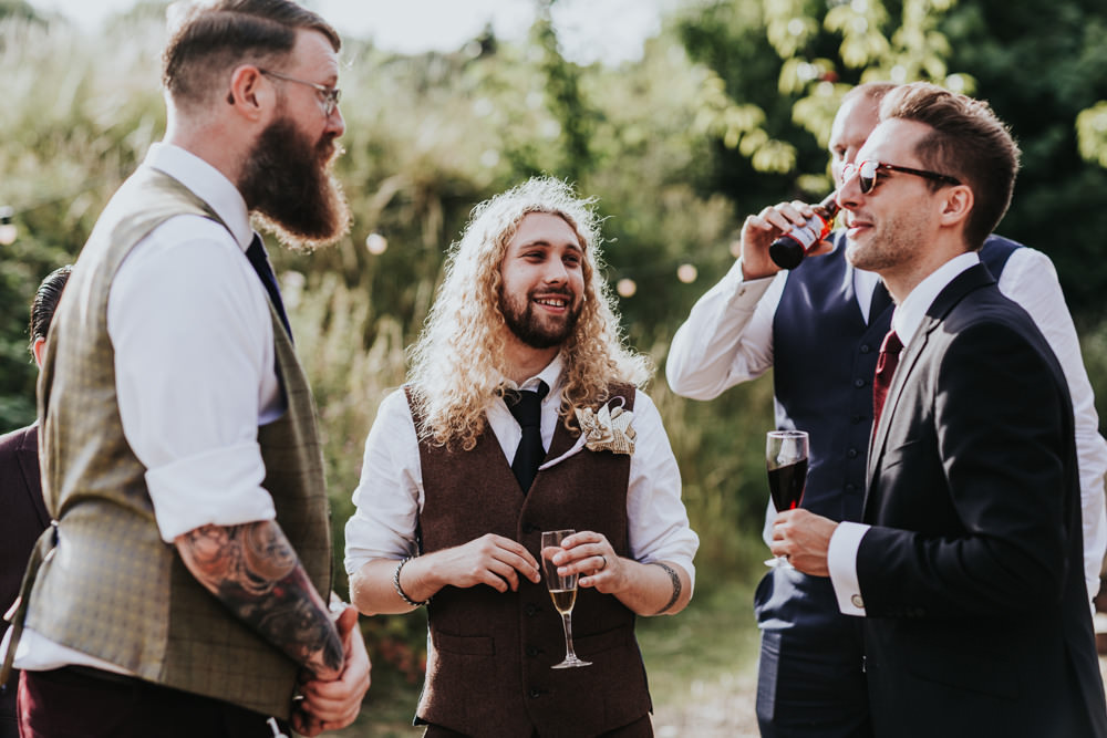 Keeper and The Dell Boho Farm Field Marquee DIY Alternative Rustic Groom Brown Suit Paper Rose Buttonhole | Relaxed Outdoor Wedding with 1000 Rainbow Origami Cranes Dan Biggins Photography