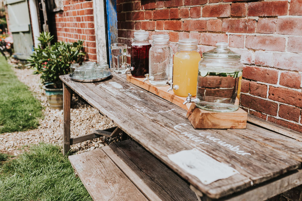 Keeper and The Dell Boho Farm Field Marquee DIY Alternative Rustic Drinks Station Cocktails Jugs Kilner | Relaxed Outdoor Wedding with 1000 Rainbow Origami Cranes Dan Biggins Photography