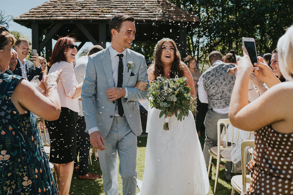 Intimate Outdoor Natural Relaxed Laid Back Summer Gazebo Ceremony Aisle Groom Bride Foliage Greenery Bouquet Confetti | Prested Hall Wedding Grace Elizabeth Photography