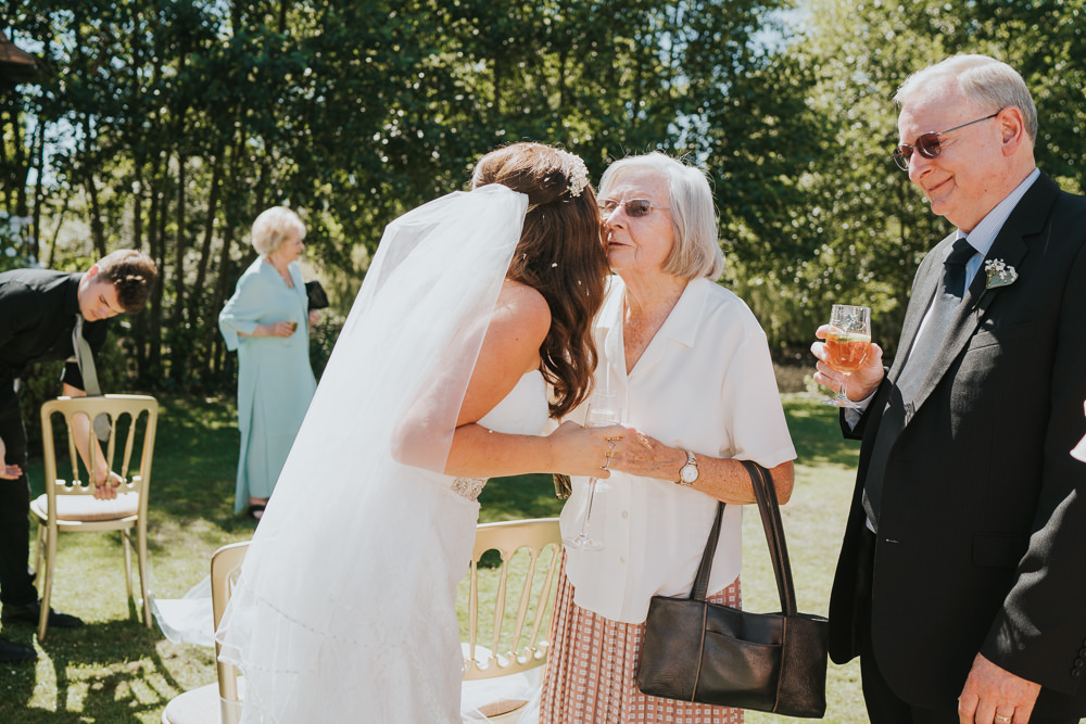 Intimate Outdoor Natural Relaxed Laid Back Summer Bride Veil Drinks Reception | Prested Hall Wedding Grace Elizabeth Photography