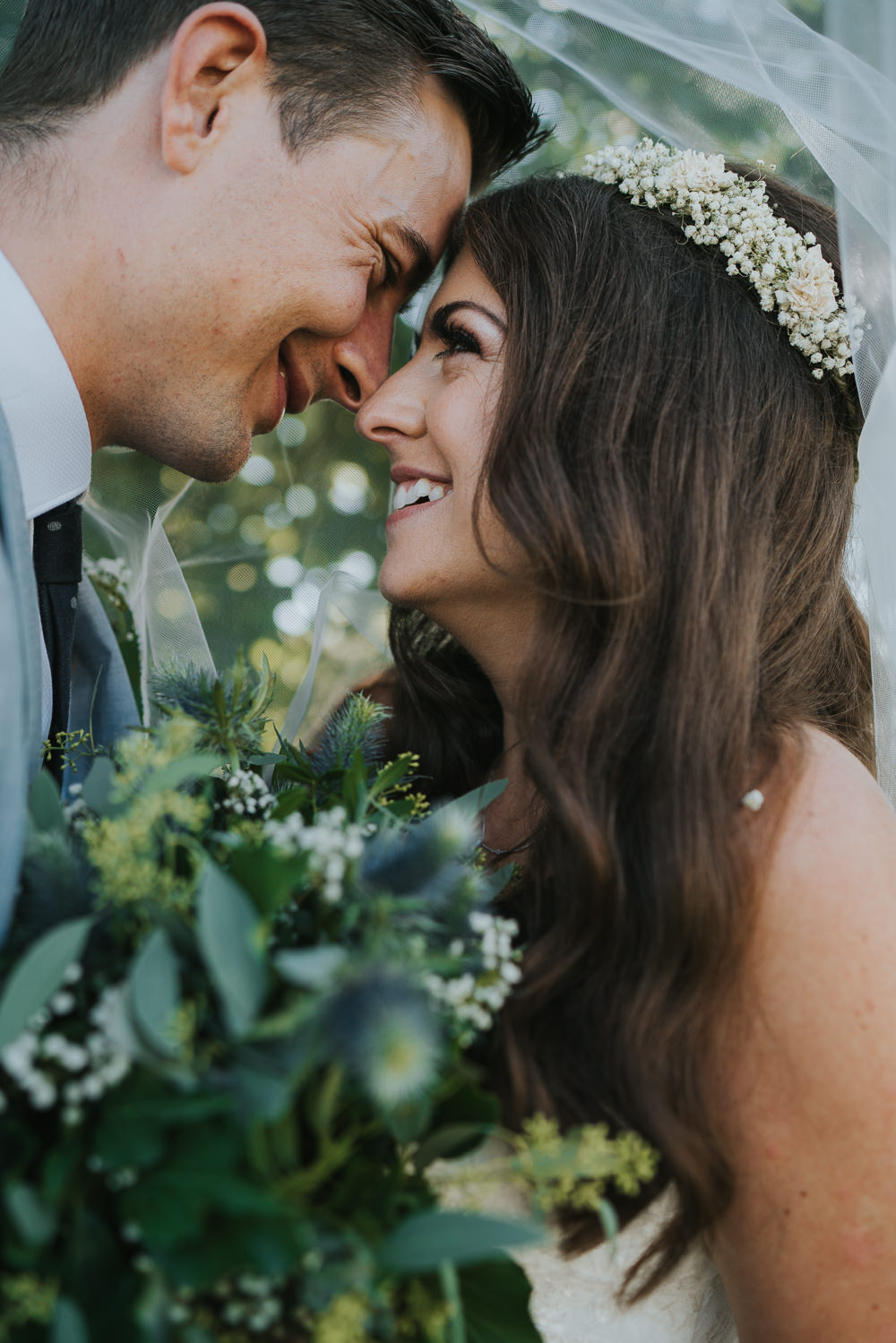Intimate Outdoor Natural Relaxed Laid Back Summer Bride Groom Kiss Greenery Foliage Bouquet Gypsophila Crown | Prested Hall Wedding Grace Elizabeth Photography