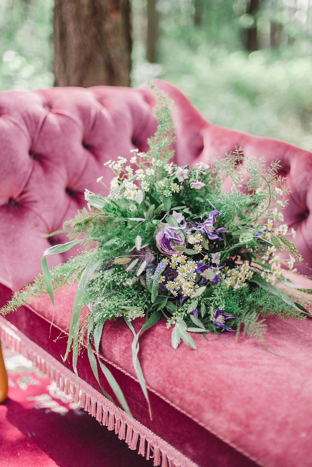 Velvet Chair Sofa Seat Bride Bridal Flowers Bouquet Greenery Foliage Purple Rose Daisy Wild Boho Woodland Wedding Ideas Camp Katur Emily Olivia Photography