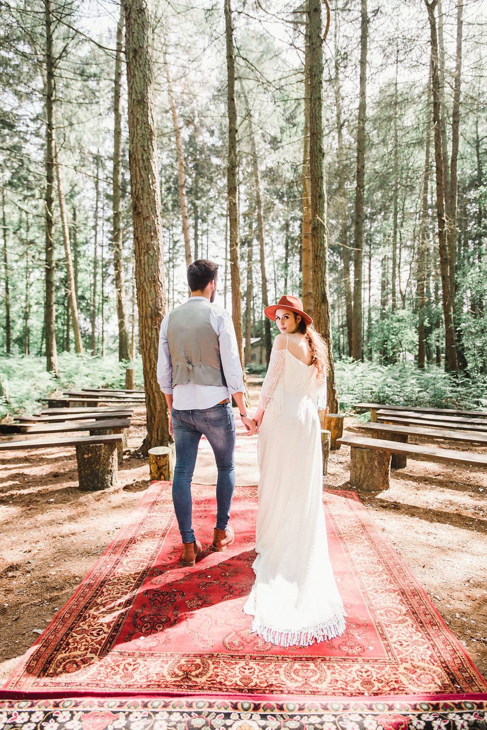 Persian Rug Outdoor Aisle Ceremony Fedora Hat Accessory Bride Bridal Gown Dress Fringed Tassel Bohemian Sleeves Train Boho Woodland Wedding Ideas Camp Katur Emily Olivia Photography