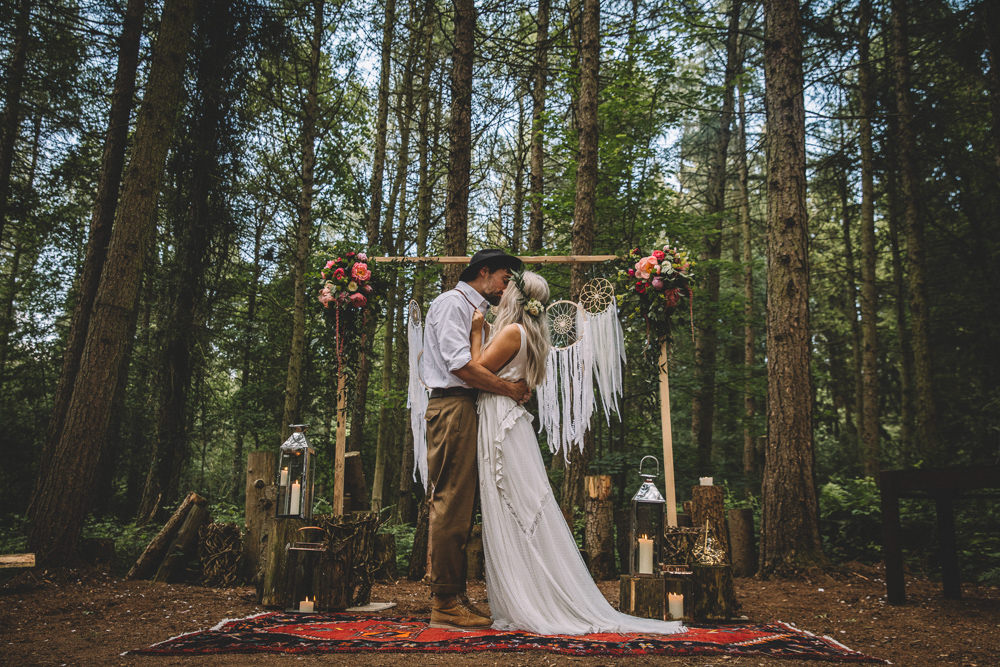 Ceremony Backdrop Wooden Frame Log Stumps Candles Persian Rug Aisle Dreamcatchers Flowers Bohemian Boho Free Spirited Wedding Ideas Woodland Lumiere Photographic