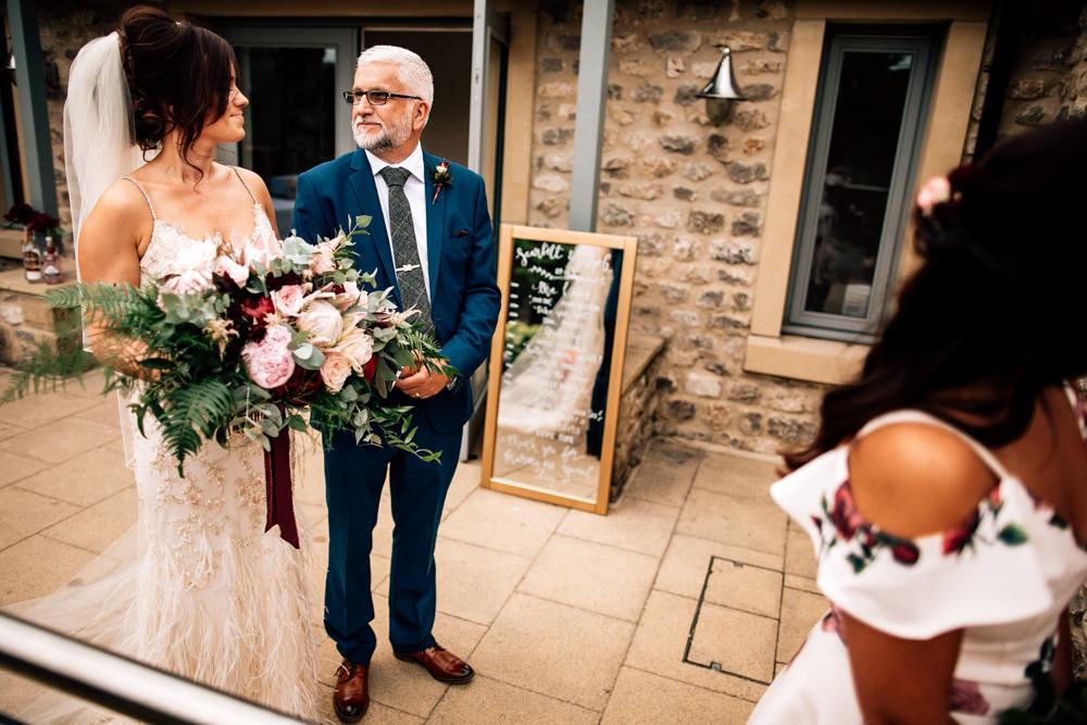 Bouquet Flowers Bride Bridal Red Pink Burgundy Protea Rose Asilbe Peony Fern Ribbons Gamekeepers Inn Wedding Fairclough Studios