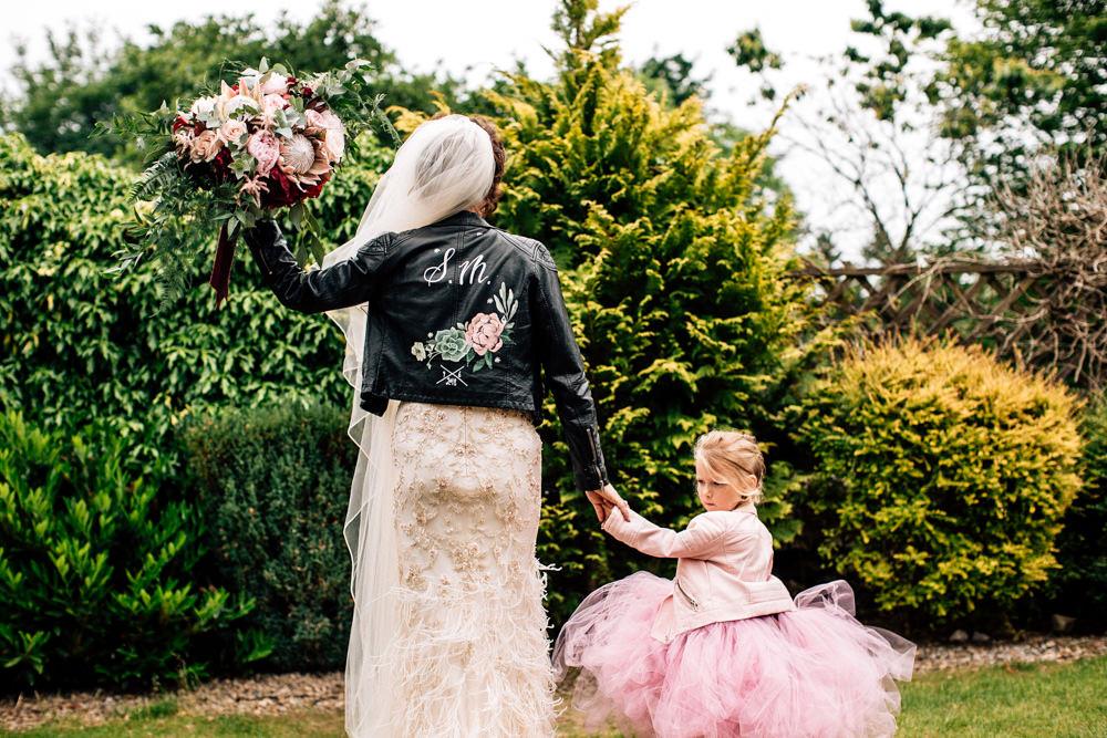 Dress Gown Bride Bridal Enzonai Feathers Veil Skirt Leather Jacket Painted Gamekeepers Inn Wedding Fairclough Studios