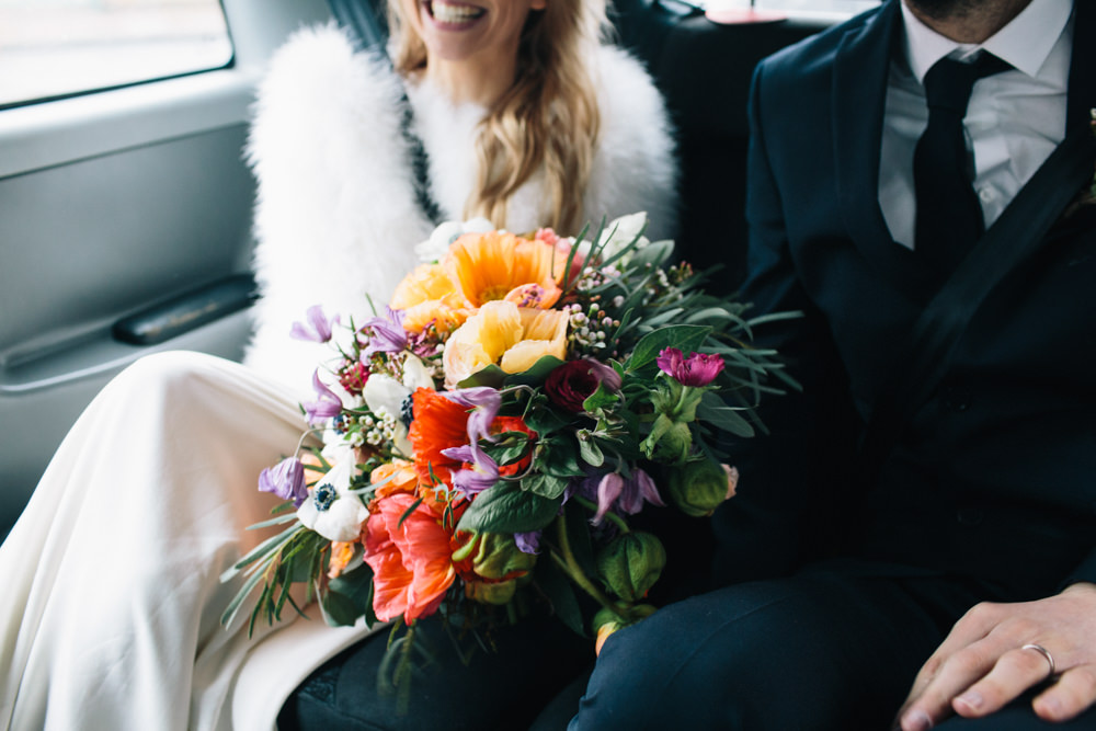 Bride Bridal Bouquet Flowers Bright Colourful Icelandic Poppies Mauve Roses Ranunculus Anemones Wax London Elopement Wedding Asylum Robbins Photographic