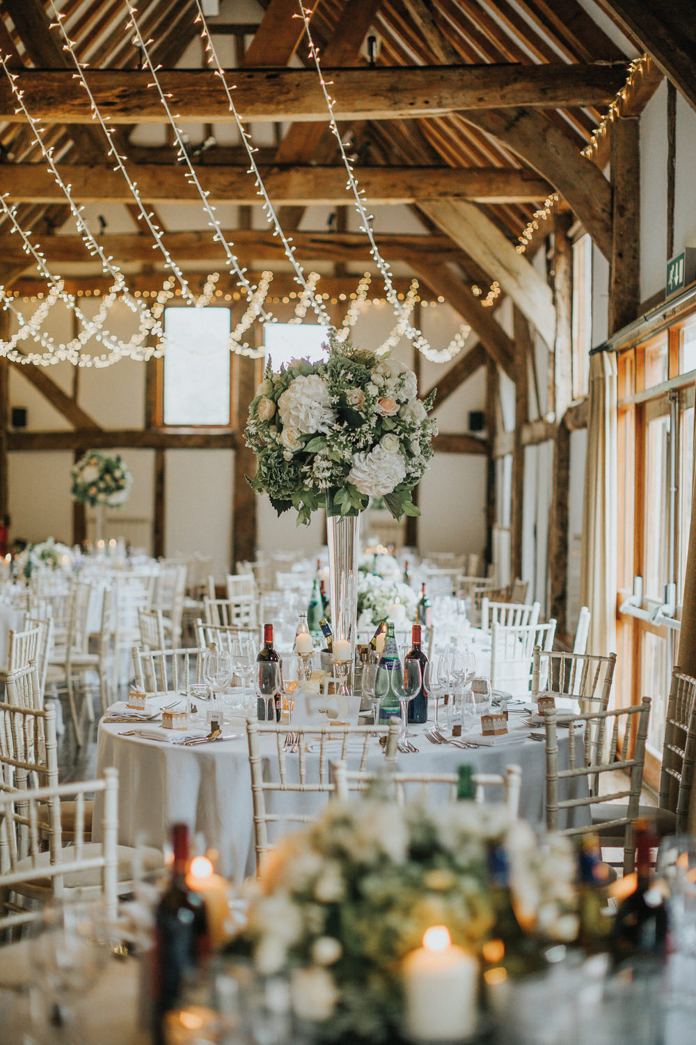 Tall table Centre Greenery White Peach Blush Roses Fairy Light Canopy Loseley Park Wedding Kit Myers Photography