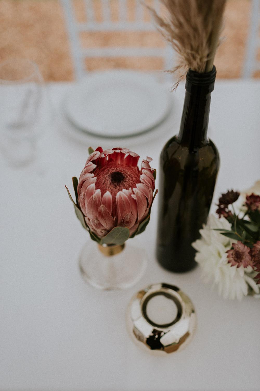 Protea Table Flowers Bottle Slovenia Wedding Bohemian Maja Tsolo Photography