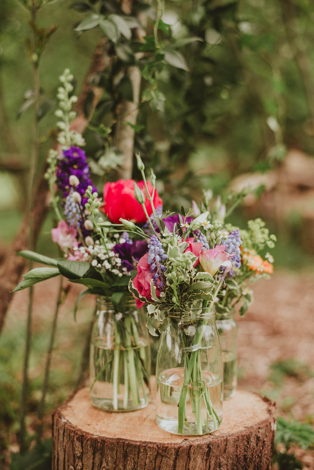 Colourful Jar Flowers Log Stump Tree Peony Stocks Plush Tents Glamping Wedding Big Bouquet Photography