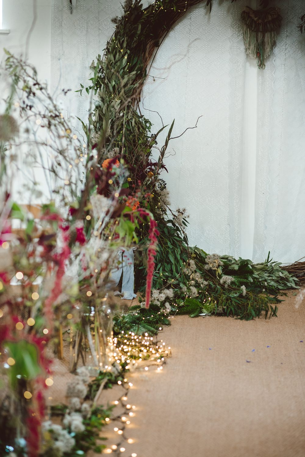 Moongate Flower Arch Backdrop Ceremony Conifer Eucalyptus Greenery Foliage Aisle Fairy Lights Rustic Christmas Wedding Ideas Dhw Photography