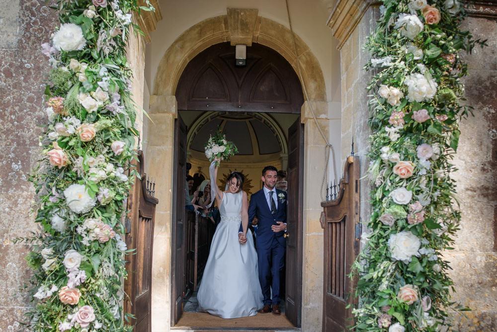 Bride Bridal A Line Dress Straps Sleeveless Silk Boat Neck Neck Blue Suit Groom Veil Flowers Floral Entrance Babington House Wedding Ria Mishaal Photography