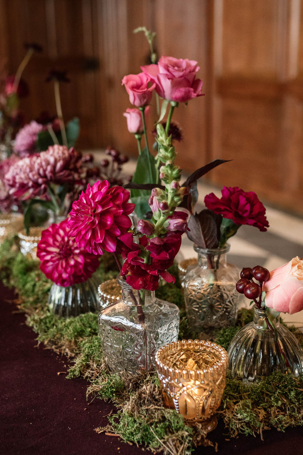Bottle Flowers Table Centrepiece Decor Red Pink Moss Gold Dahlia Rose Winter Luxe Wedding Ideas Becky Harley Photography