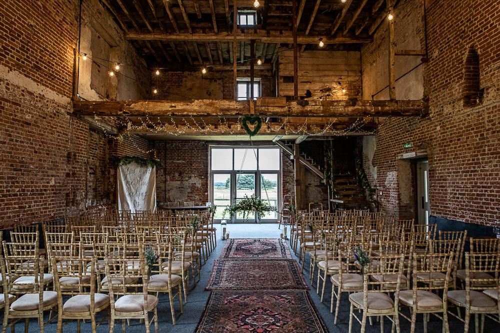 Persian Rug Aisle Greenery Lighting Ceremony Decor Rustic Botanical Barn Wedding Lorna Newman Photography
