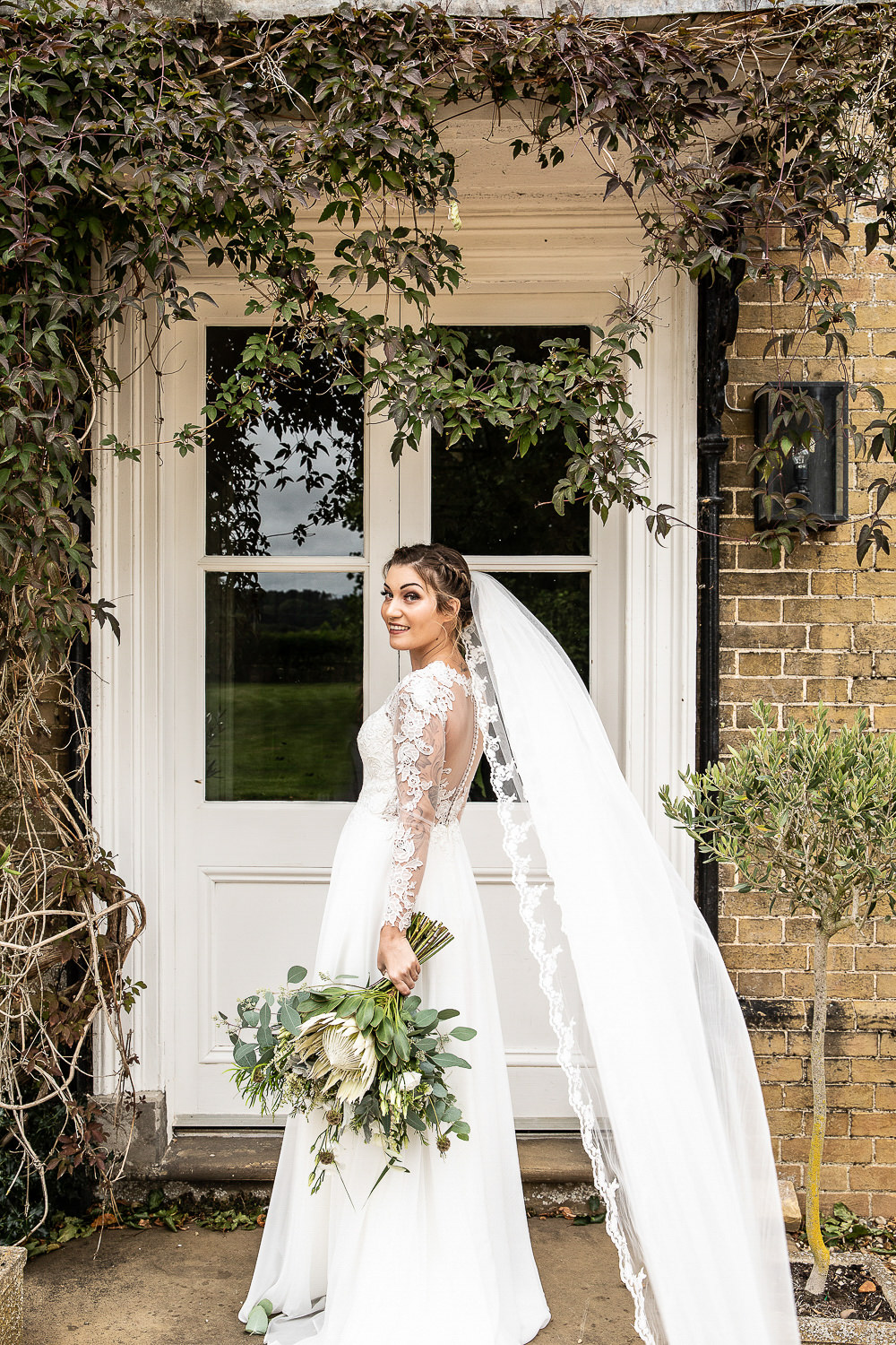 Bride Bridal Dress Gown Lace Veil Sleeves Lillian West Rustic Botanical Barn Wedding Lorna Newman Photography