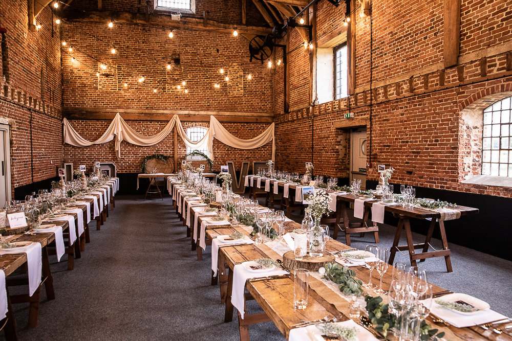 Festoon Lights Drapes Decor Long Tables Greenery Rustic Botanical Barn Wedding Lorna Newman Photography