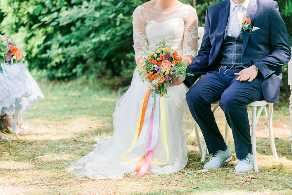 Bride Bridal Strapless Sweetheart Neckline Lace Jacket Sleeves Waistcoat Tweed Check Three Piece Suit Blue Multicoloured Bouquet Ribbon Groom Spring Cottage Rivington Wedding Emma B Photography