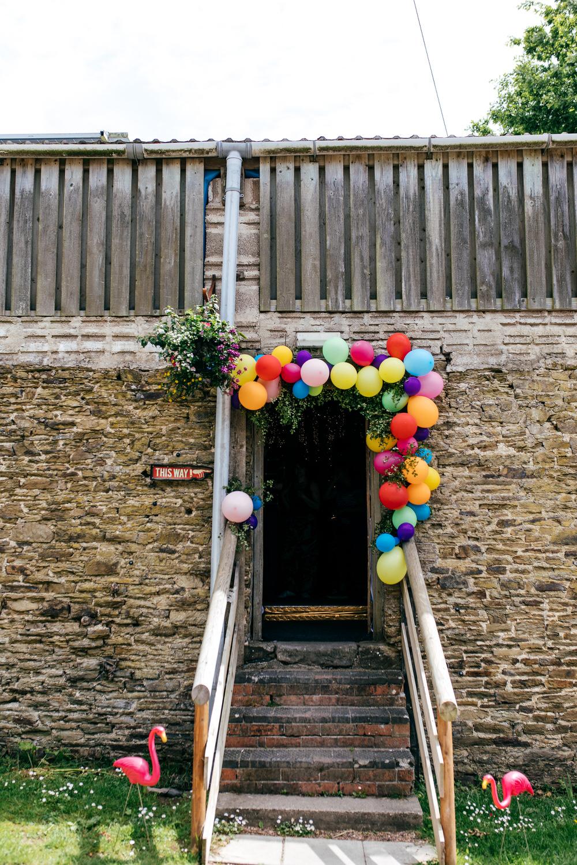 Rainbow Colourful Balloon Installation Door Ash Barton Estate Wedding Jordanna Marston Photography