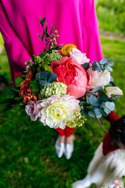 Bouquet Flowers Bridesmaid Colourful Pom Poms Peonies Ranunculus Craspedia Alliums Protea Pink Orange Ash Barton Estate Wedding Jordanna Marston Photography