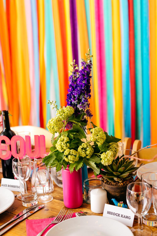 Painted Bottle Flowers Decor Table Centrepiece Rainbow Colourful Ribbon Backdrop Ash Barton Estate Wedding Jordanna Marston Photography