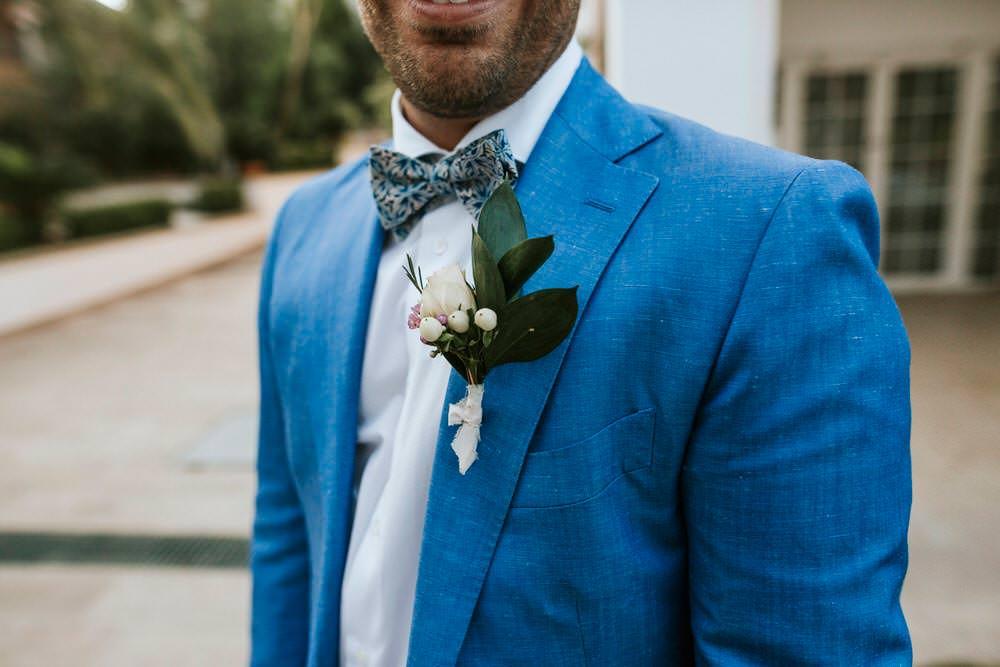 Groom Blue Suit Bow Tie Buttonhole Bohemian Beach Greece Destination Wedding Lighthouse Photography