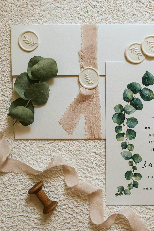 Stationery Invites Invitations Greenery Botanical Ribbons Wax Seal Flat Lay Bohemian Beach Greece Destination Wedding Lighthouse Photography