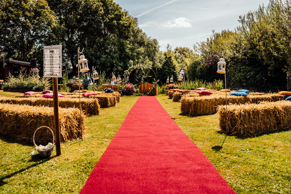 Outdoor Ceremony Red Carpet Hay Bales Shepherds Crook Lanterns Colourful Tipi Garden Wedding Fairclough Studios