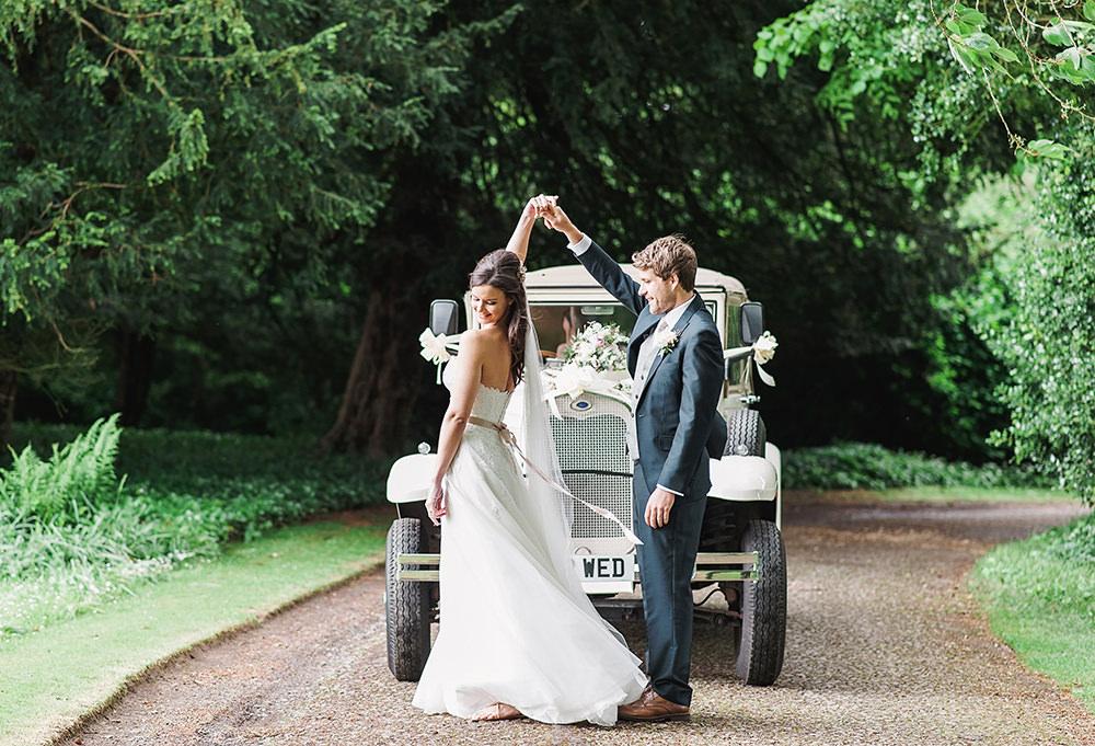 Bride Bridal Gown Dress Strapless Sweetheart Neckline Ribbon Belt Pink Blue Suit Groom Vintage Car Transport Edmondsham House Wedding Darima Frampton Photography
