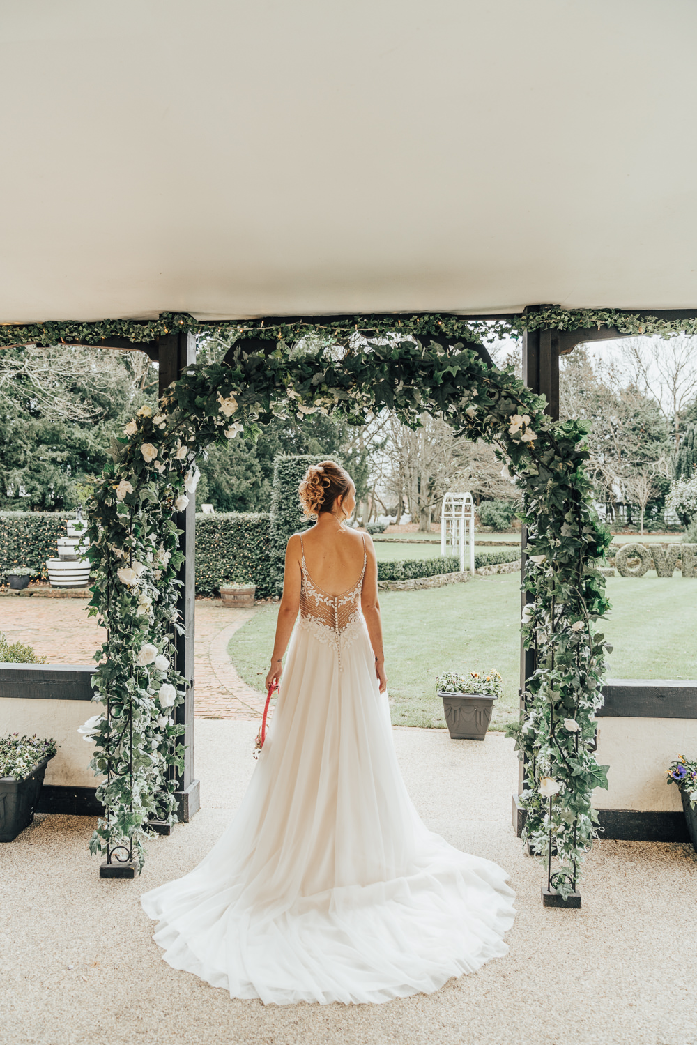Dress Gown Bride Bridal Train Beaded Lace Back Straps Greenery Foliage Arch Flower Backdrop Hoop Wedding Ideas Rebecca Carpenter Photography