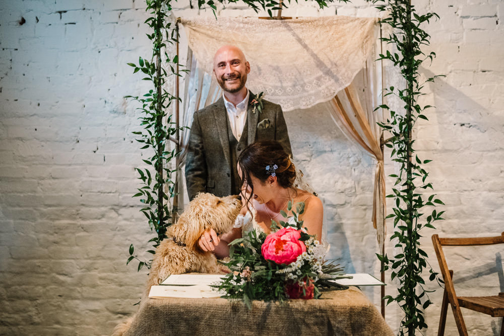 Bride Bridal Dress Gown Lace Detail Drop Cold Shoulder Ribbon Bow Sleeveless Tweed Suit Dog Waistcoat Groom Floral Veil Stanford Farm Wedding Andy Griffiths Photography