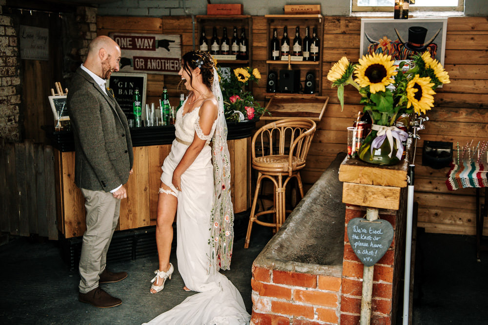 Bride Bridal Dress Gown Lace Detail Drop Cold Shoulder Ribbon Bow Sleeveless Tweed Suit Waistcoat Groom Floral Veil Garter Stanford Farm Wedding Andy Griffiths Photography