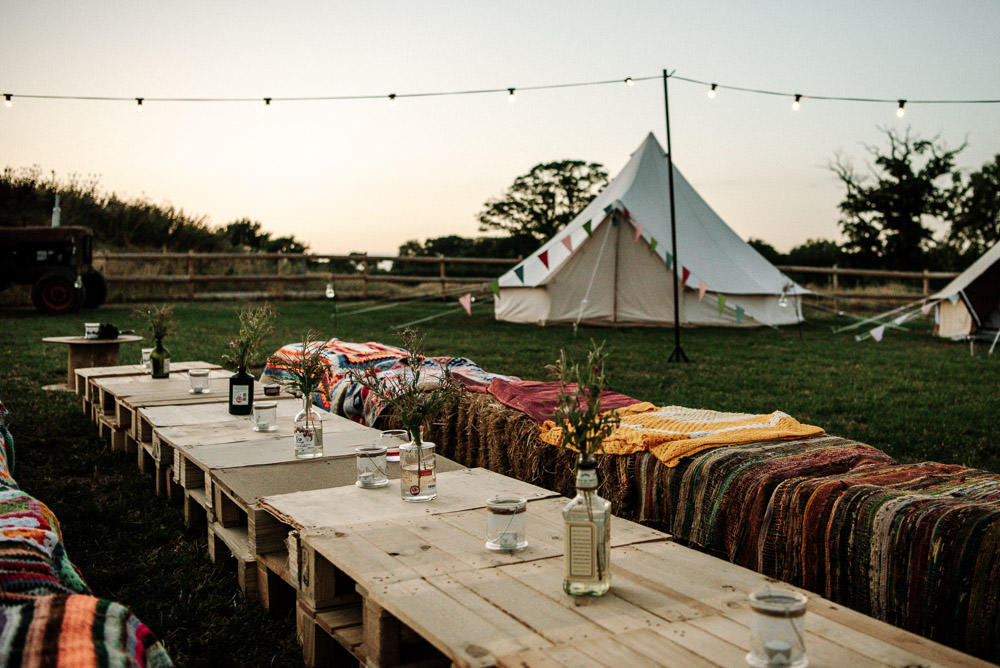 Outdoor Seating Hay Bales Pallets Boho Festoon Lighting Stanford Farm Wedding Andy Griffiths Photography