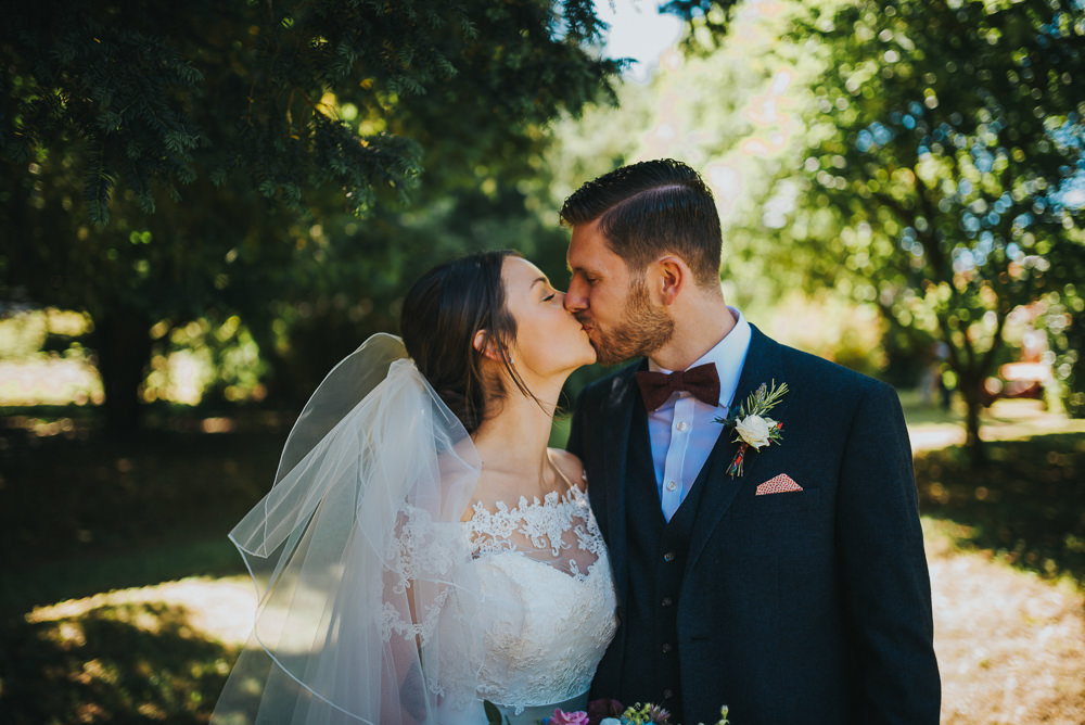 Bride Bridal Dress Gown Sweetheart Bolero Off Shoulder Lace Navy Suit Groom Burgundy Oxblood Bow Tie Veil Kittisford Barton Wedding Joab Smith Photography
