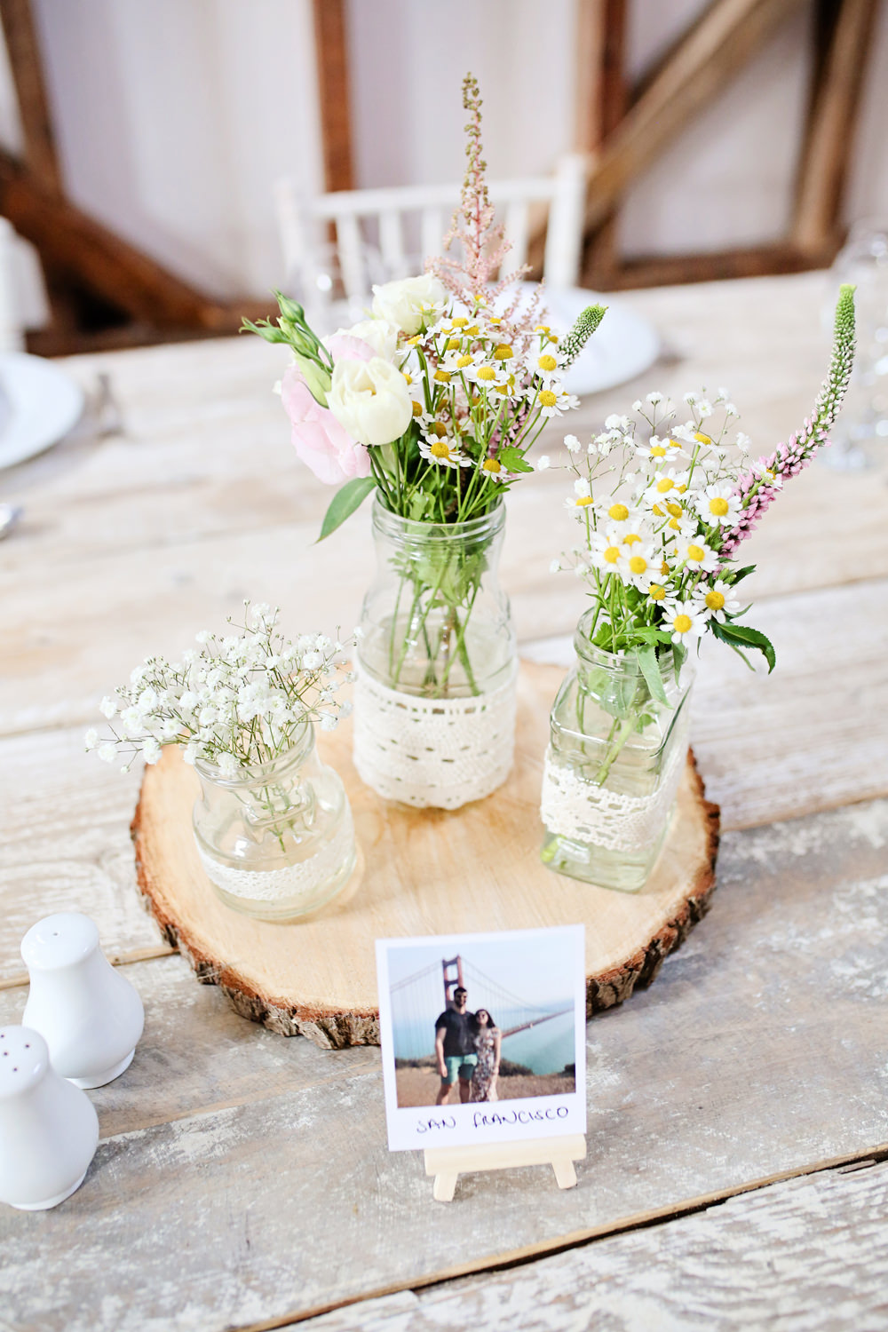 Table Centrepiece Decor Log Slice Flowers Jars Lace Milling Barn Wedding Victoria Mitchell Photography