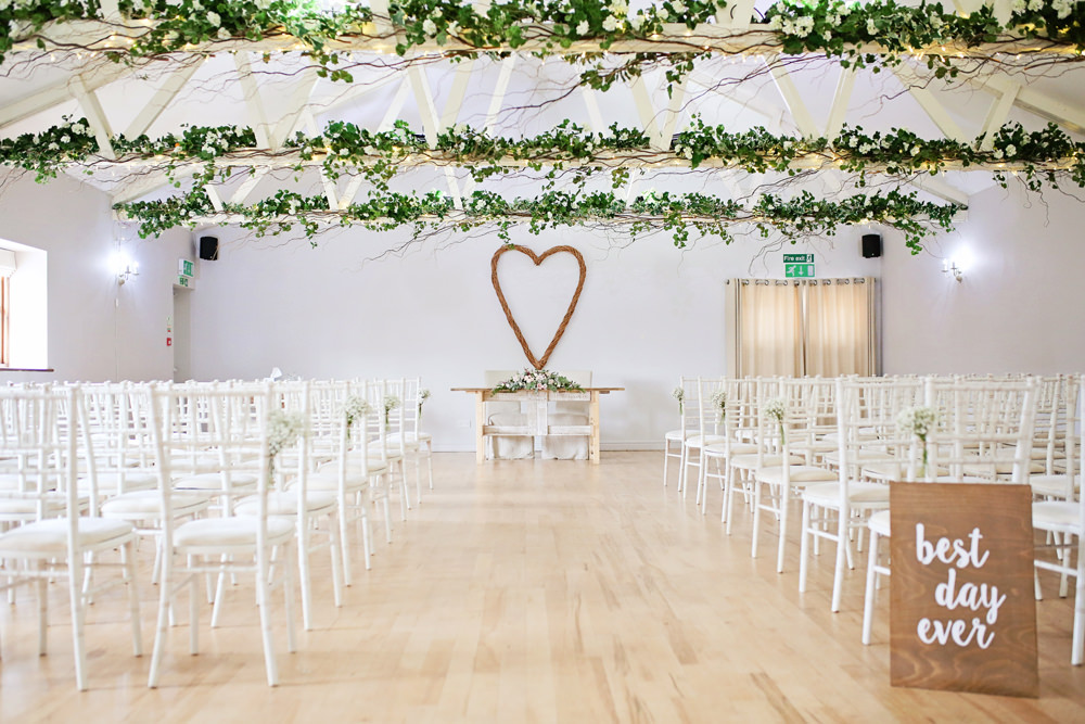 Ceremony Aisle Wooden Chairs Greenery Foliage Wicker Heart Milling Barn Wedding Victoria Mitchell Photography