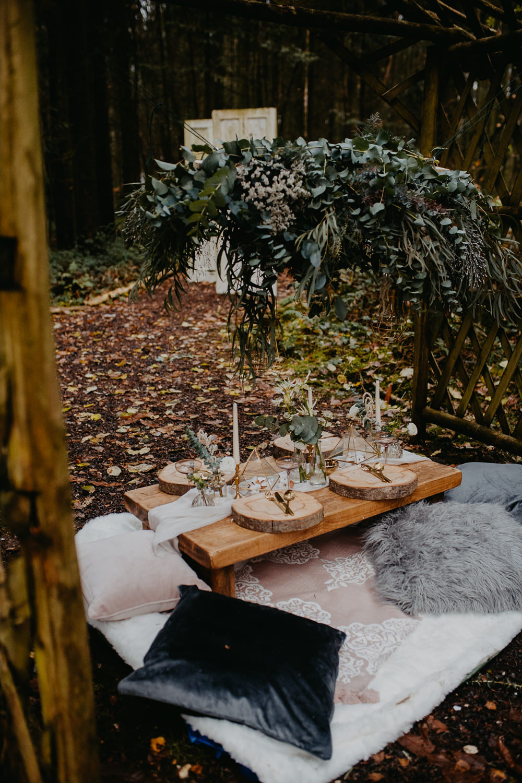 Tablescape Decor Table Greenery Foliage Suspended Hanging Installation Outdoor Woodland Wedding Ideas Geometric Meraki Wedding PhotographyTablescape Decor Table Greenery Foliage Suspended Hanging Installation
