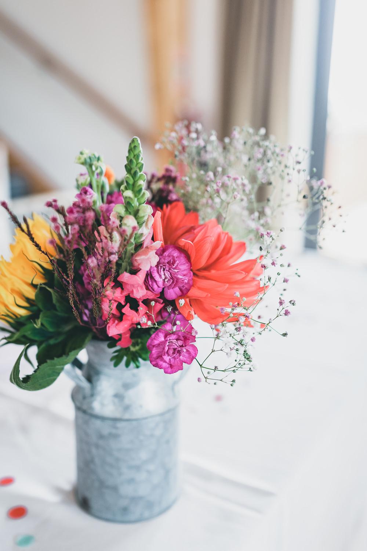 Milk Churn Table Flowers Centrepiece Colourful Decor Rock Village Hall Wedding Lucie Hamilton Photography