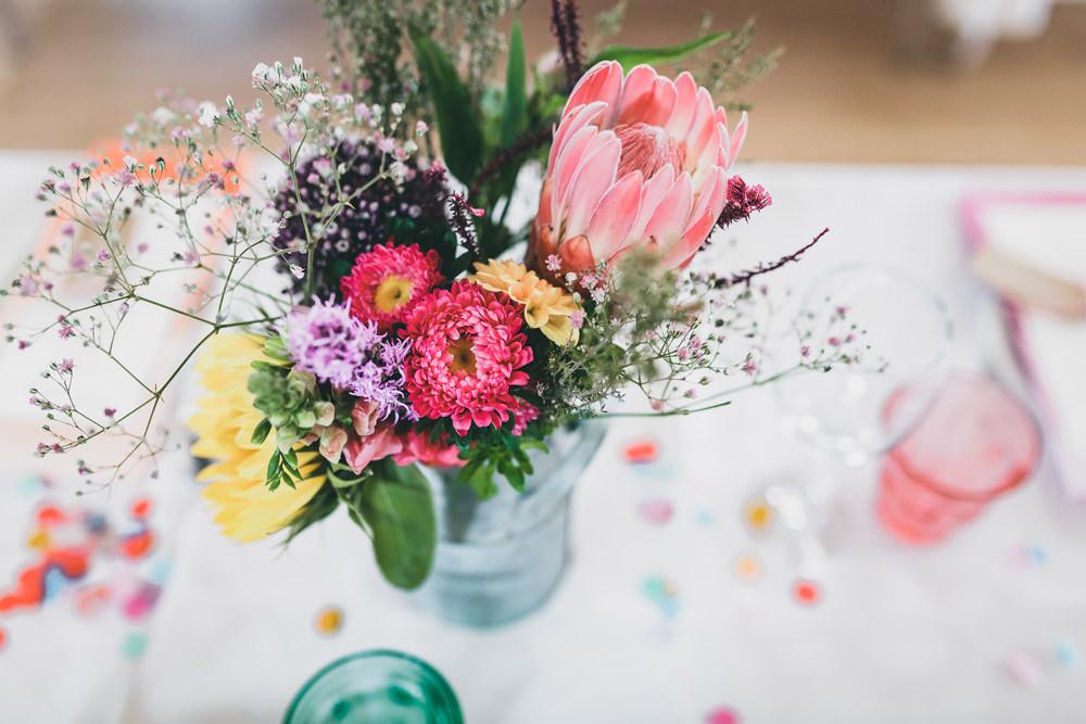 Milk Churn Table Flowers Centrepiece Colourful Decor Protea Rock Village Hall Wedding Lucie Hamilton Photography