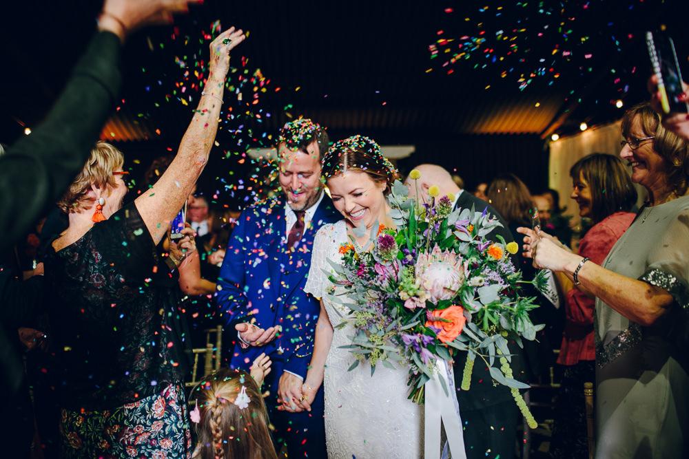 Bride Bridal V Neck Sleeves Beaded Detail Dress Gown Blue Suit Groom Tropical Bouquet Confetti Tatton Wedding Stock Farm Barn Amy B Photography