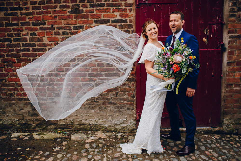 Bride Bridal V Neck Sleeves Beaded Detail Dress Gown Blue Suit Groom Veil Tropical Bouquet Tatton Wedding Stock Farm Barn Amy B Photography